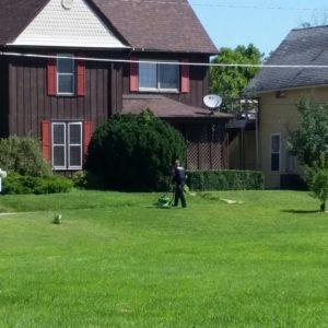 Vinton+Cop+Mows+Grass